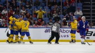 Sweden Holds on to Advance to World Junior Finals